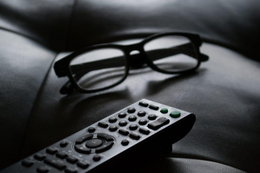 black-and-white-blur-remote control and glasses